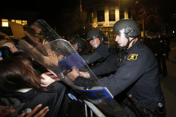 Police officers with the Berkeley Police Department clash with protesters during a march in Berkeley