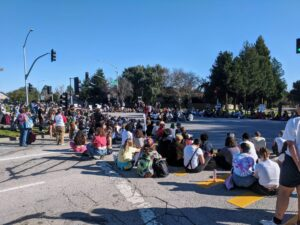 Students sit in a circle listening to speakers during UCSC grad student strike picket on Feb. 10, 2020